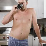 man with pot belly drinking coffee in his underwear